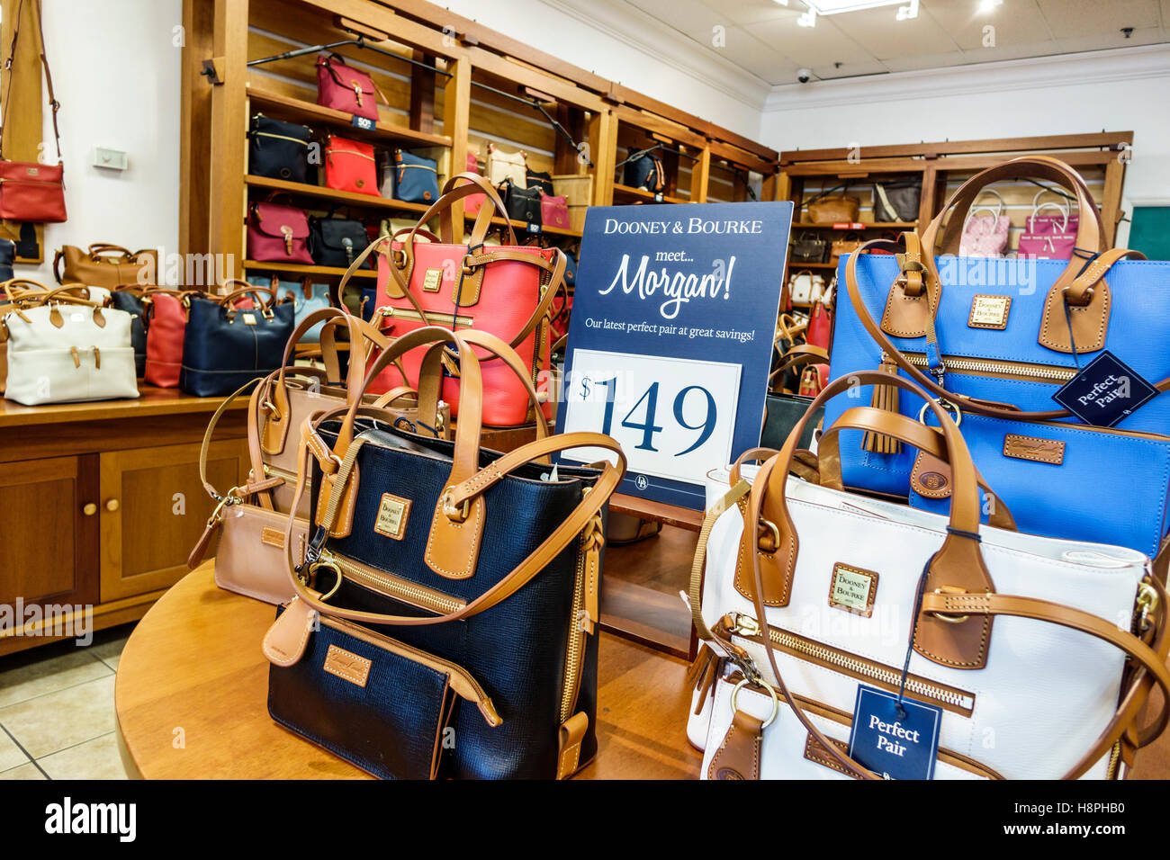 a2dc3d6a7ba Vero Beach Florida shopping Dooney & Bourke interior sale display women's  handbags Morgan