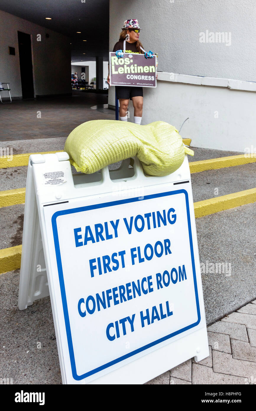 Miami Florida Beach polling place station presidential elections early voting sign campaigner - Stock Image