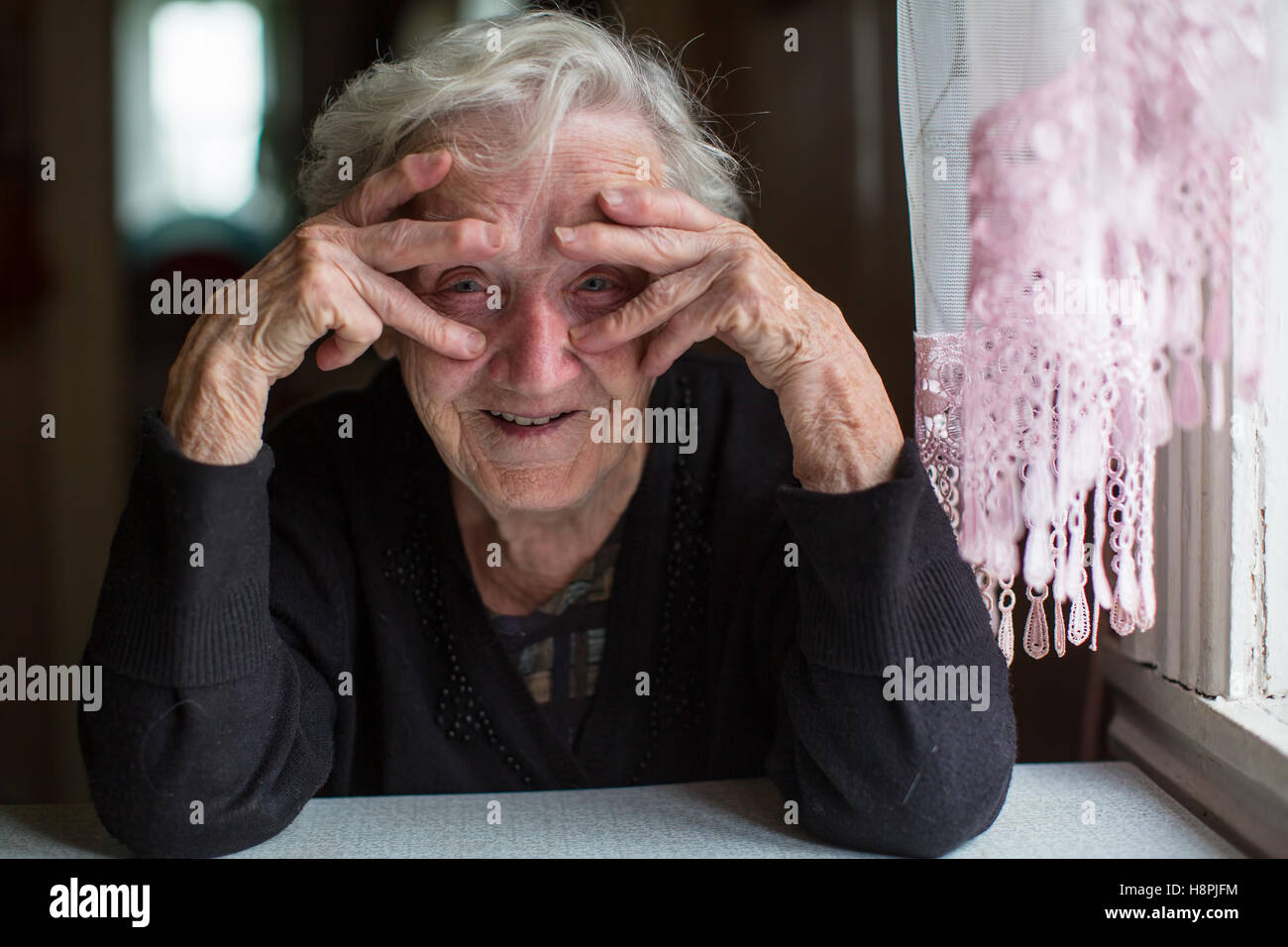 Portrait of funny elderly woman. Stock Photo