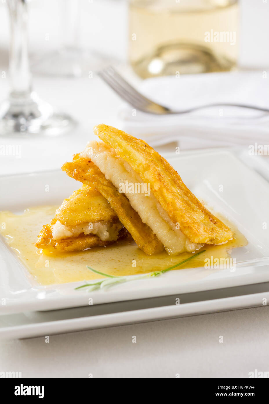 Sole fish fillet, served with banana an a sauce. - Stock Image