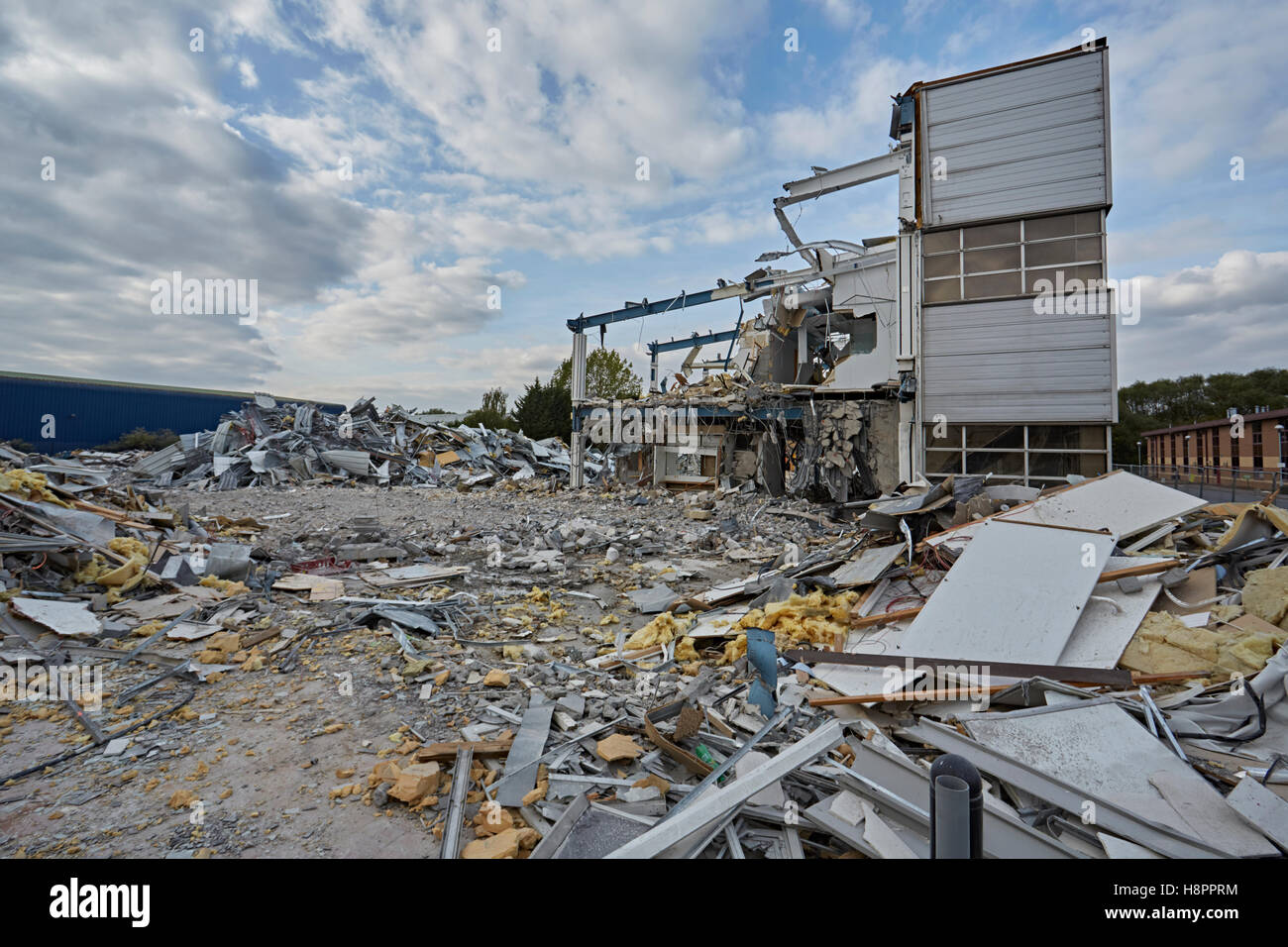 Office building partly demolished with a corner section still standing, England, United Kingdom, UK - Stock Image