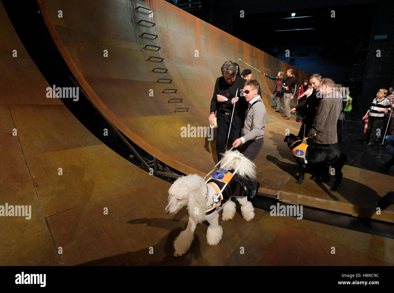 Leipzig, Germany. 18th Nov, 2016. Blind and visually impaired people as well as their companions explore the stage - Stock Image