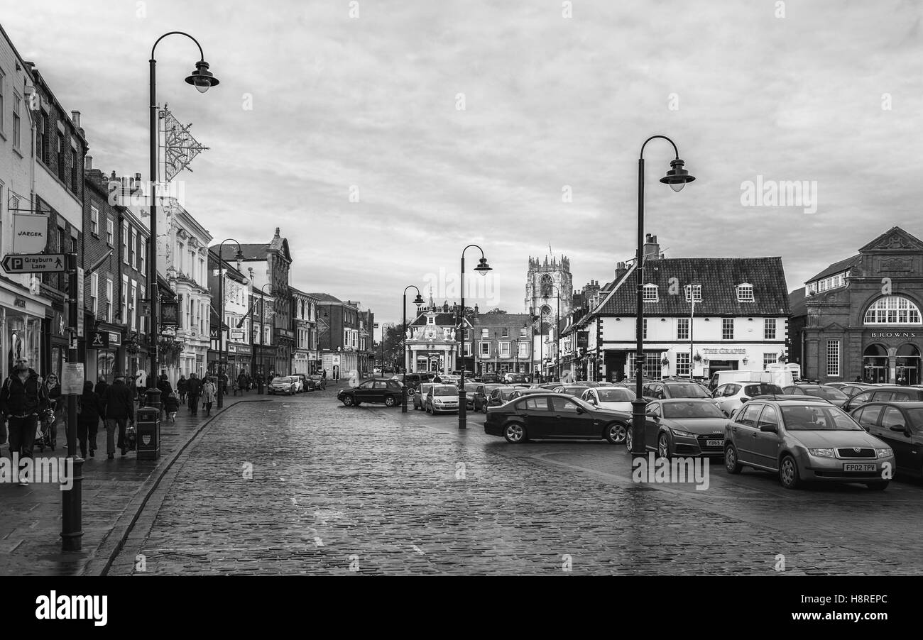 Beverley town centre with view of car park, shops, St Marys Church, and the bandstand on an overcast day in autumn. - Stock Image