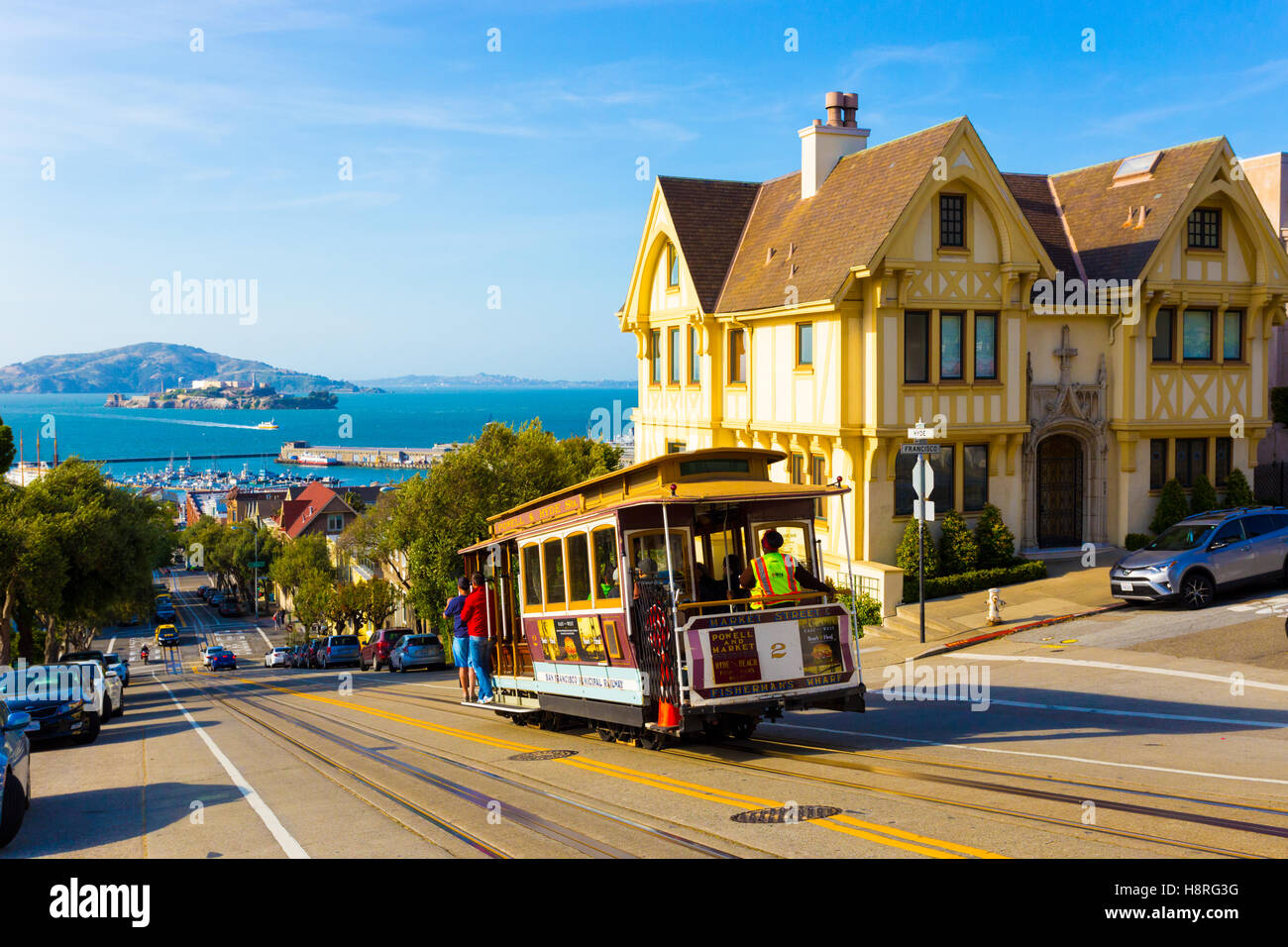 Combined scenic view of San Francisco Bay with Alcatraz, cable car, Victorian houses, typical iconic siteseeing - Stock Image