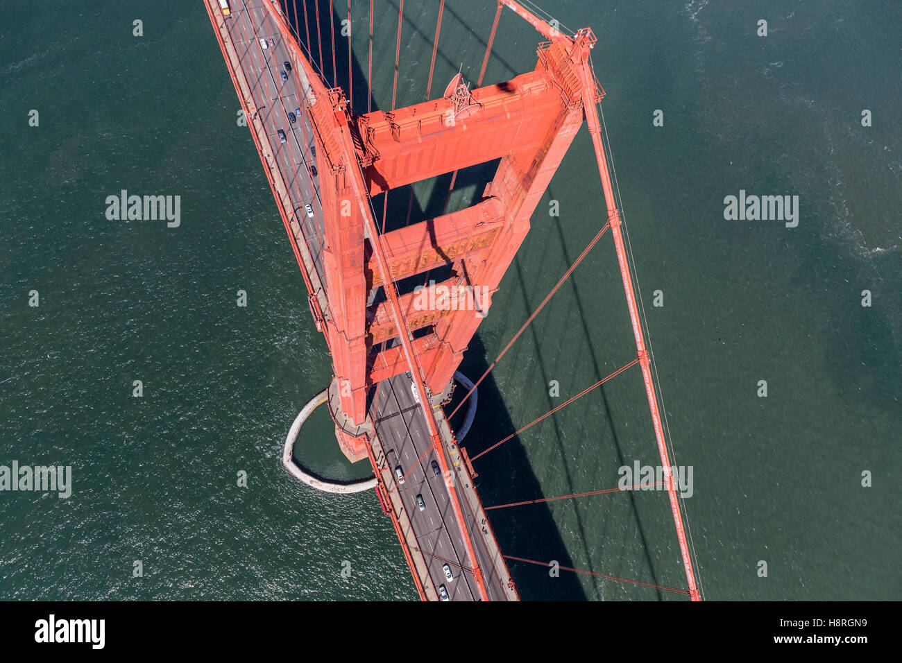 Aerial down view of Golden Gate Bridge tower and San Francisco Bay. - Stock Image