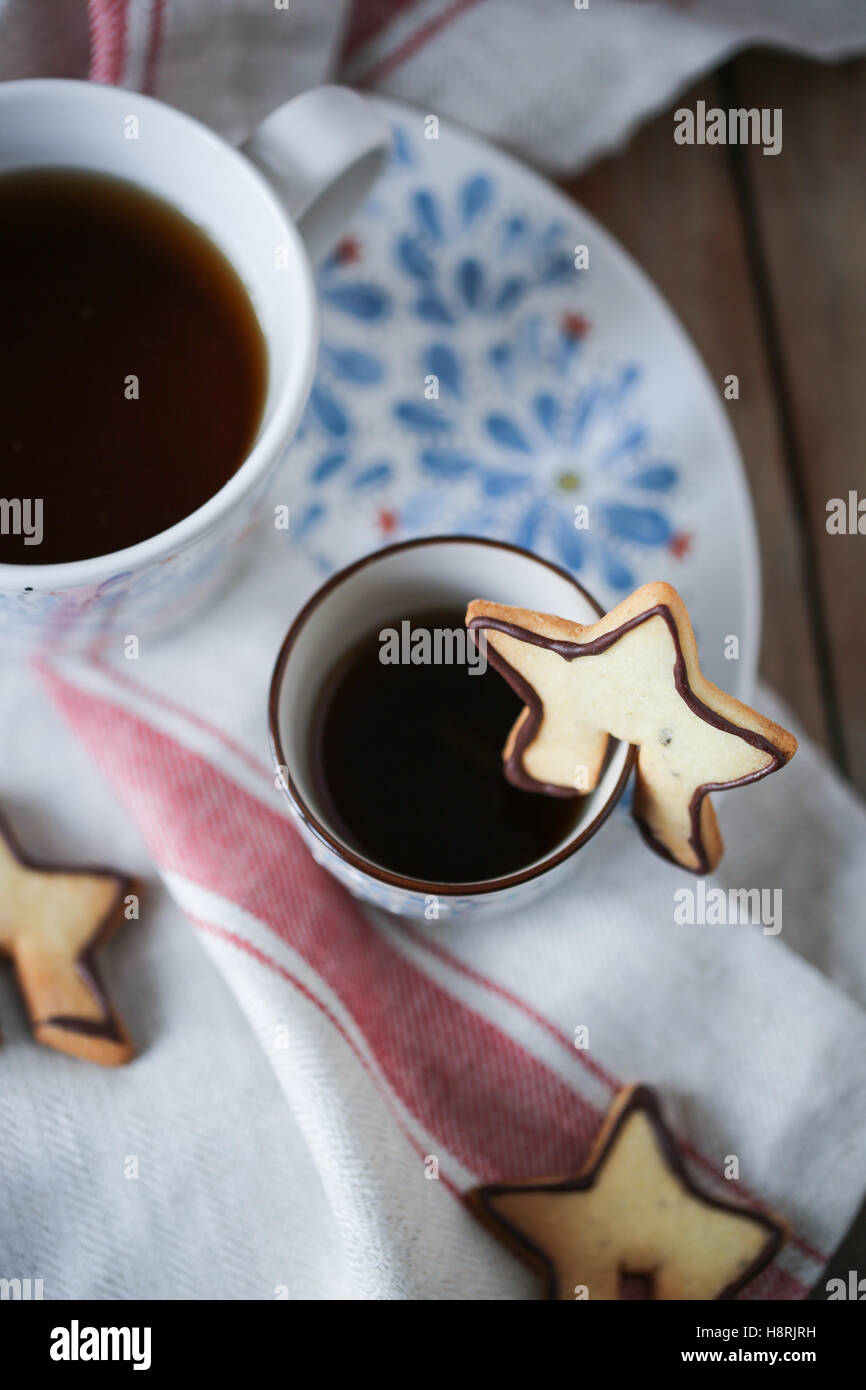 Cup with tea and biscuits - Stock Image