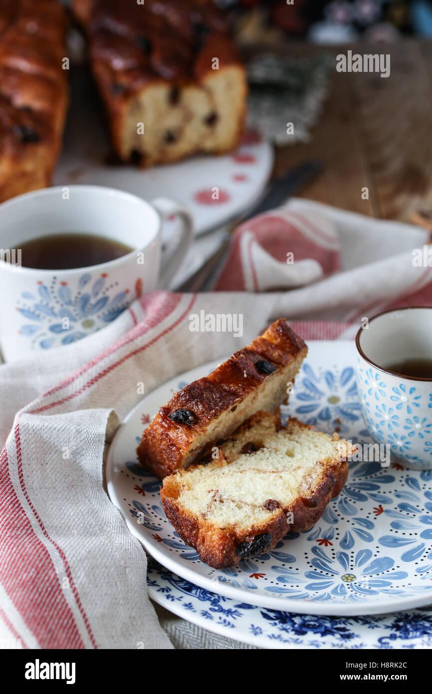 tea and slices of cinnamon raisins brioche - Stock Image