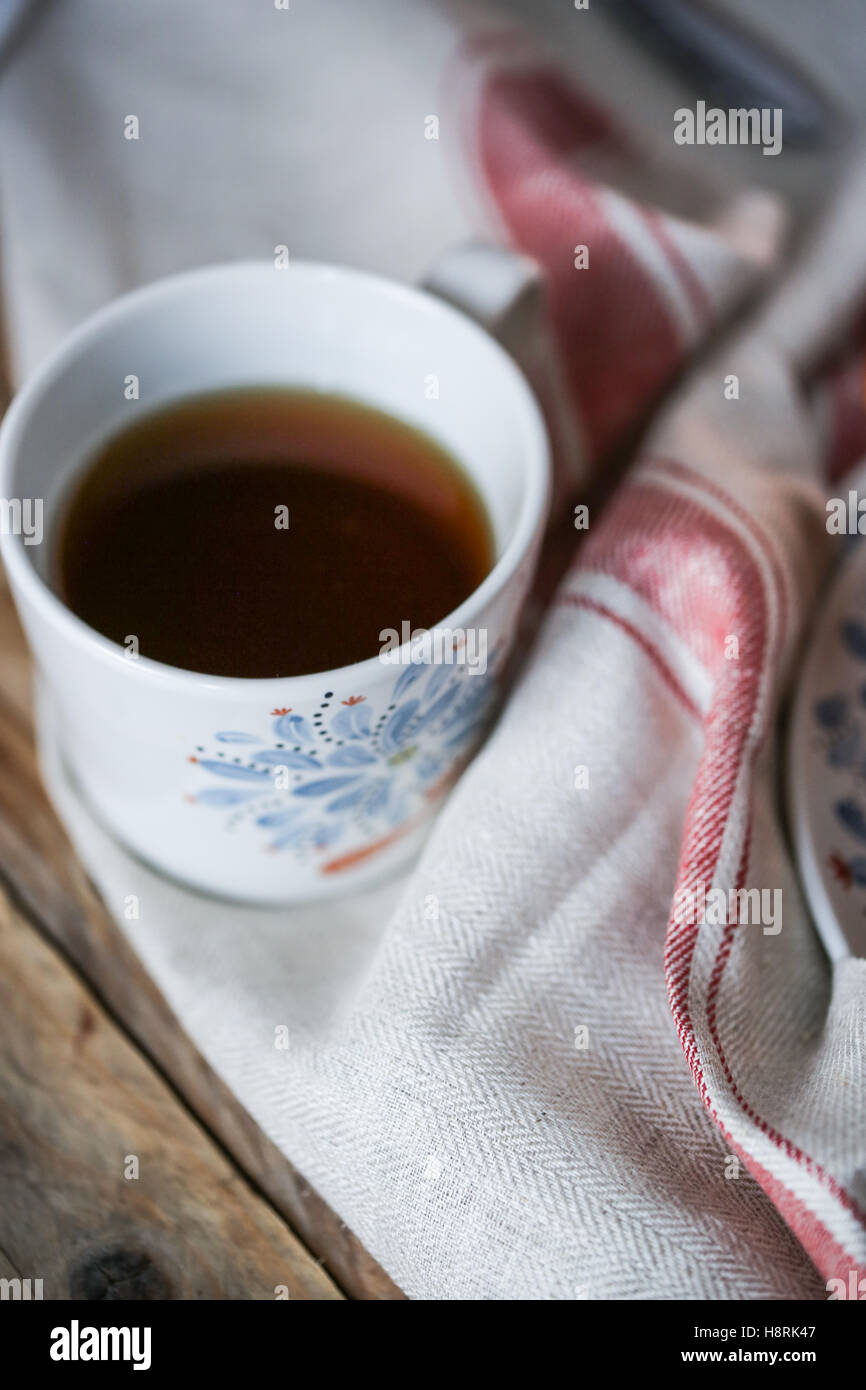 White and blue cup with tea - Stock Image