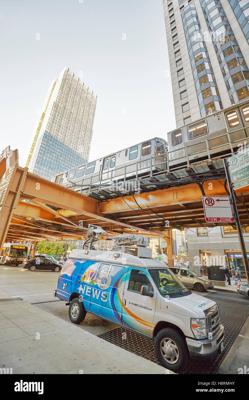 Chicago, USA - October 13, 2016: Wide angle picture of NBC 5 News van parked on the street under subway bridge. - Stock Image