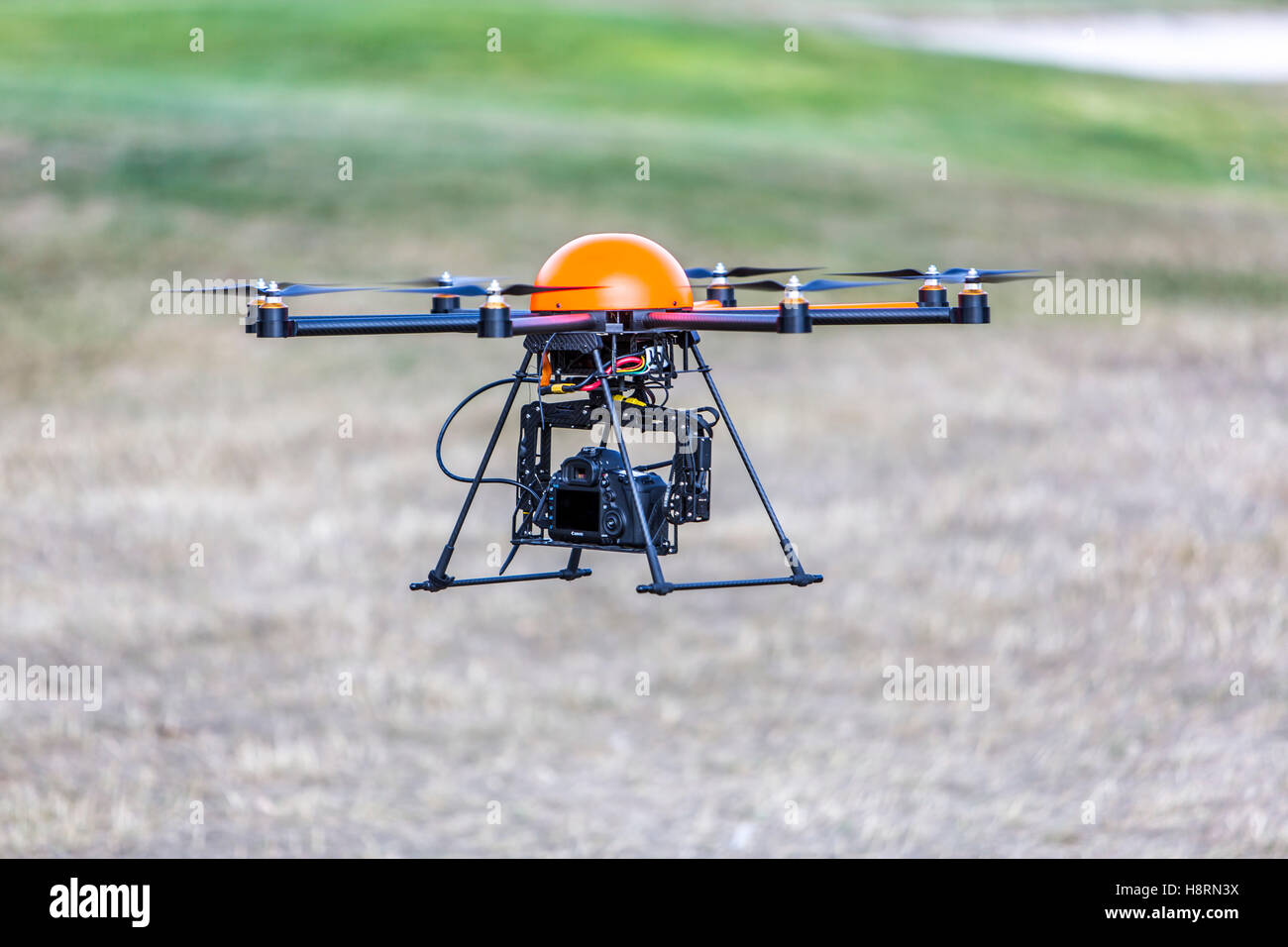 Drone, multi copter, octocopter, with a camera system, professional drone for areal photography, filming, - Stock Image