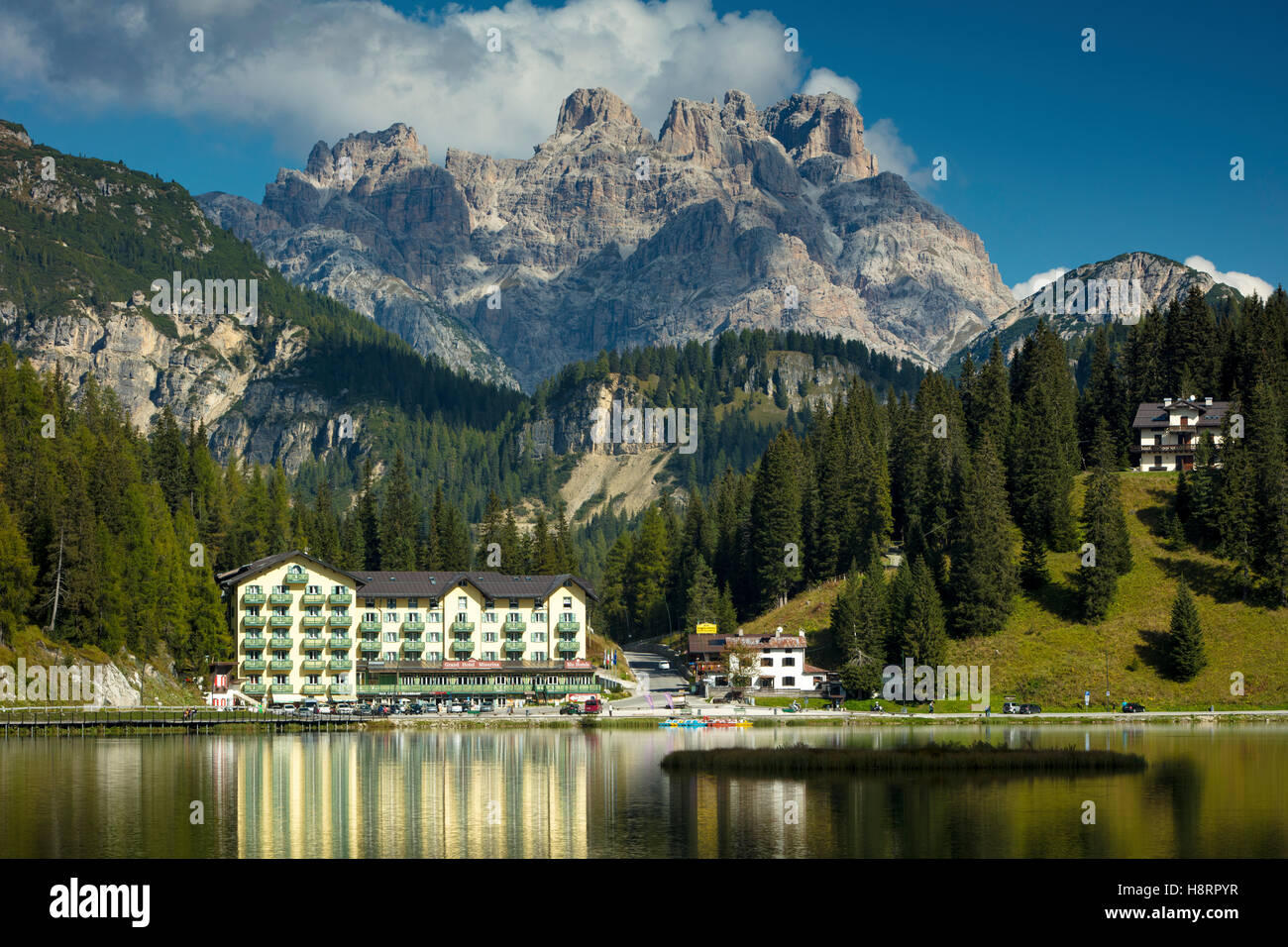 Reflections of the Grand Hotel Misurina in Lago Misurina with the Cristallo looming beyond, Dolomites, Belluno, - Stock Image