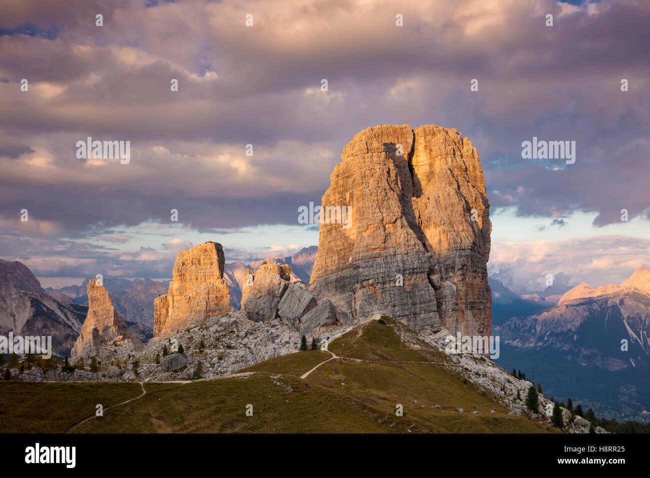 Evening sunlight over the Cinque Torri, Dolomite Mountains, Belluno, Veneto, Italy - Stock Image