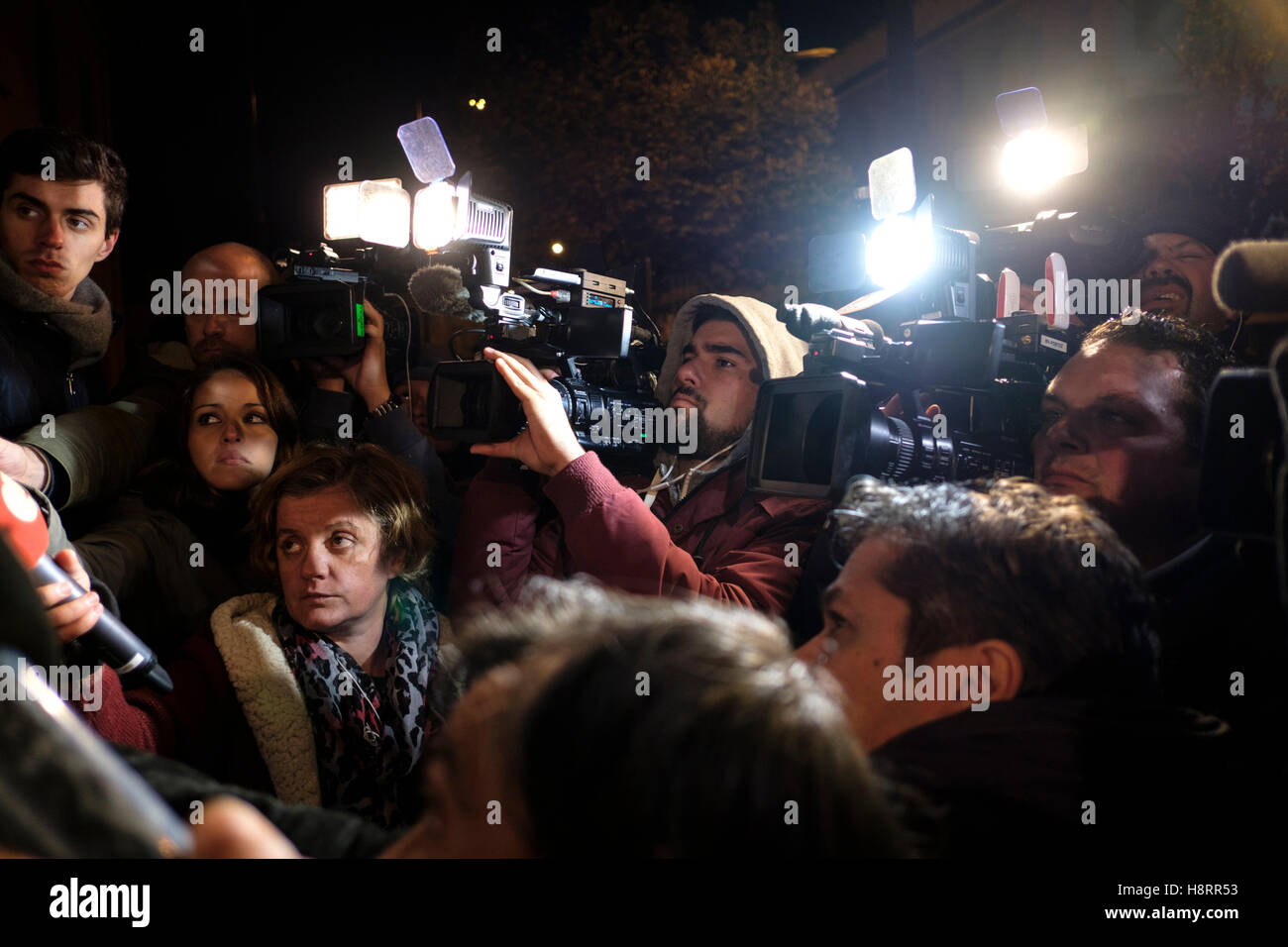 News cameramen covering an event at night - Stock Image