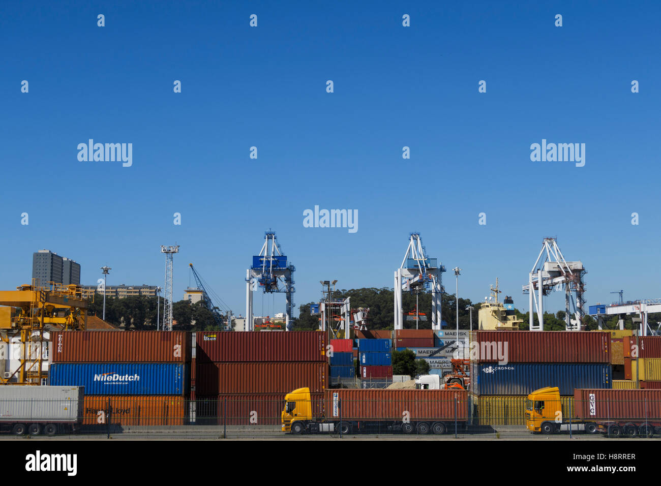Shipping containers, trucks and cranes at Leixões port in Matosinhos, Portugal, Europe Stock Photo