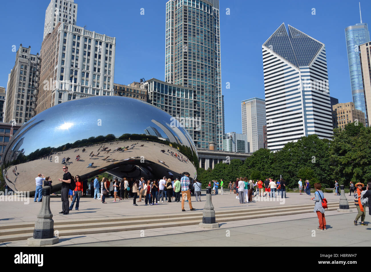 the chicago skyline backs up cloud gate or the bean in millennium