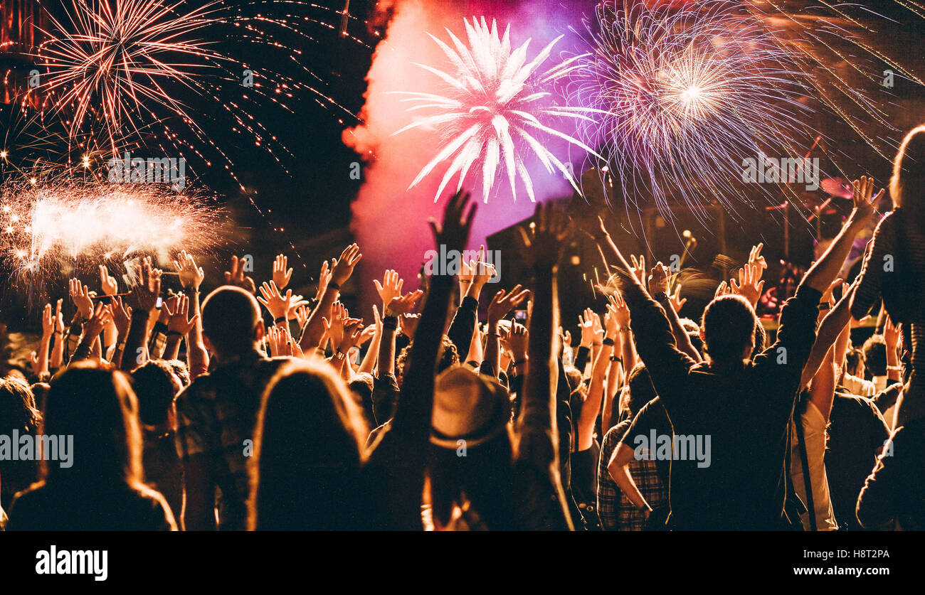 cheering crowd and fireworks - New Year celebration concept Stock Photo - Alamy