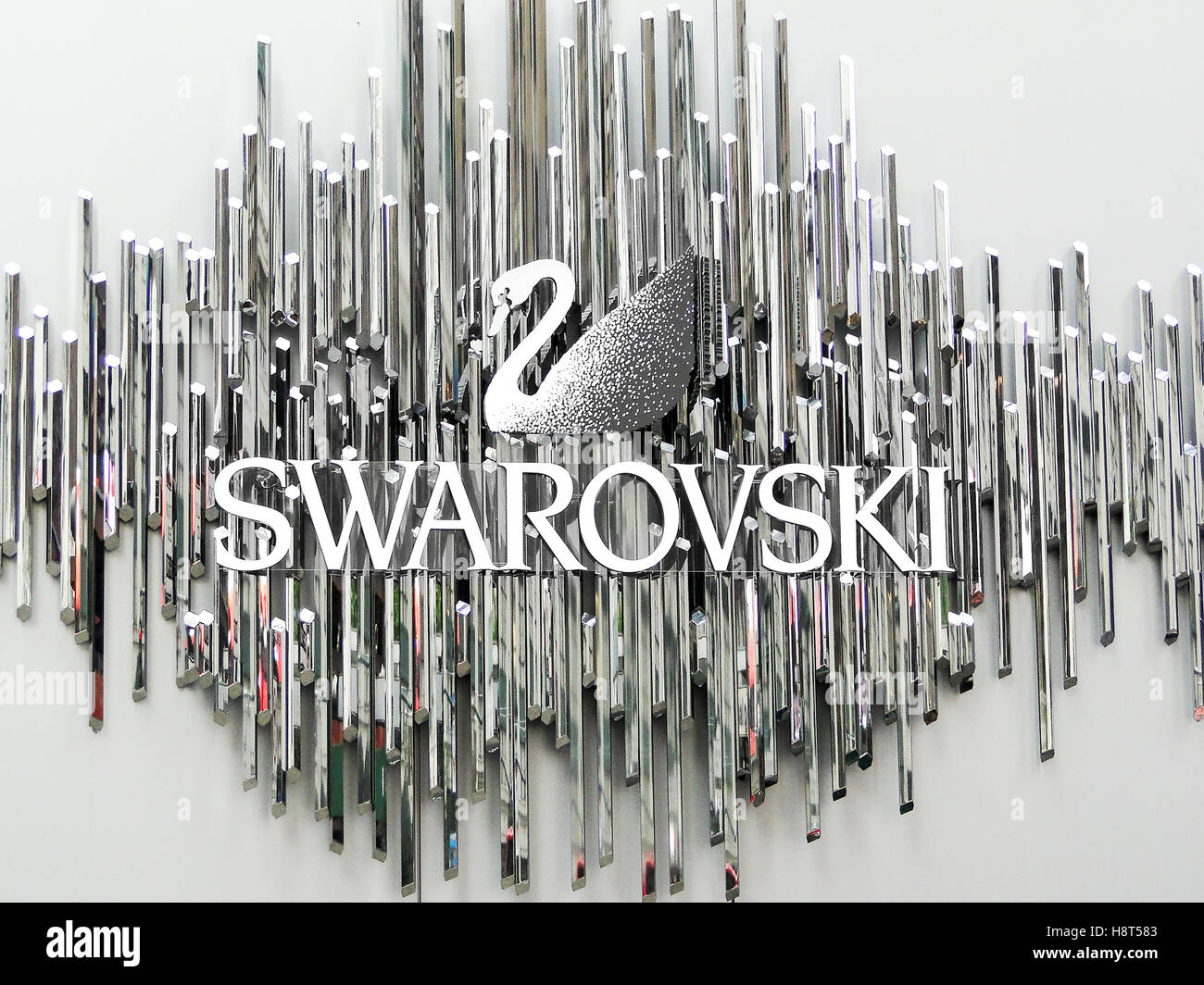 8adc56bbbbc6 The Swarovski swan symbol and logo on a wall Stock Photo  125920819 ...