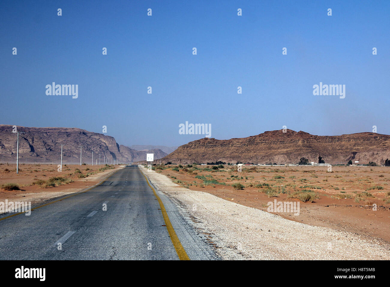 Desert road to, Valley of Wadi Rum, desert in Jordan - Stock Image