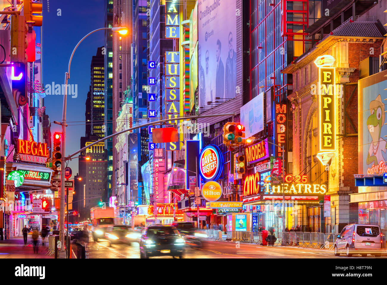 Traffic moves below the illuminated signs of 42nd Street in New York City. Stock Photo