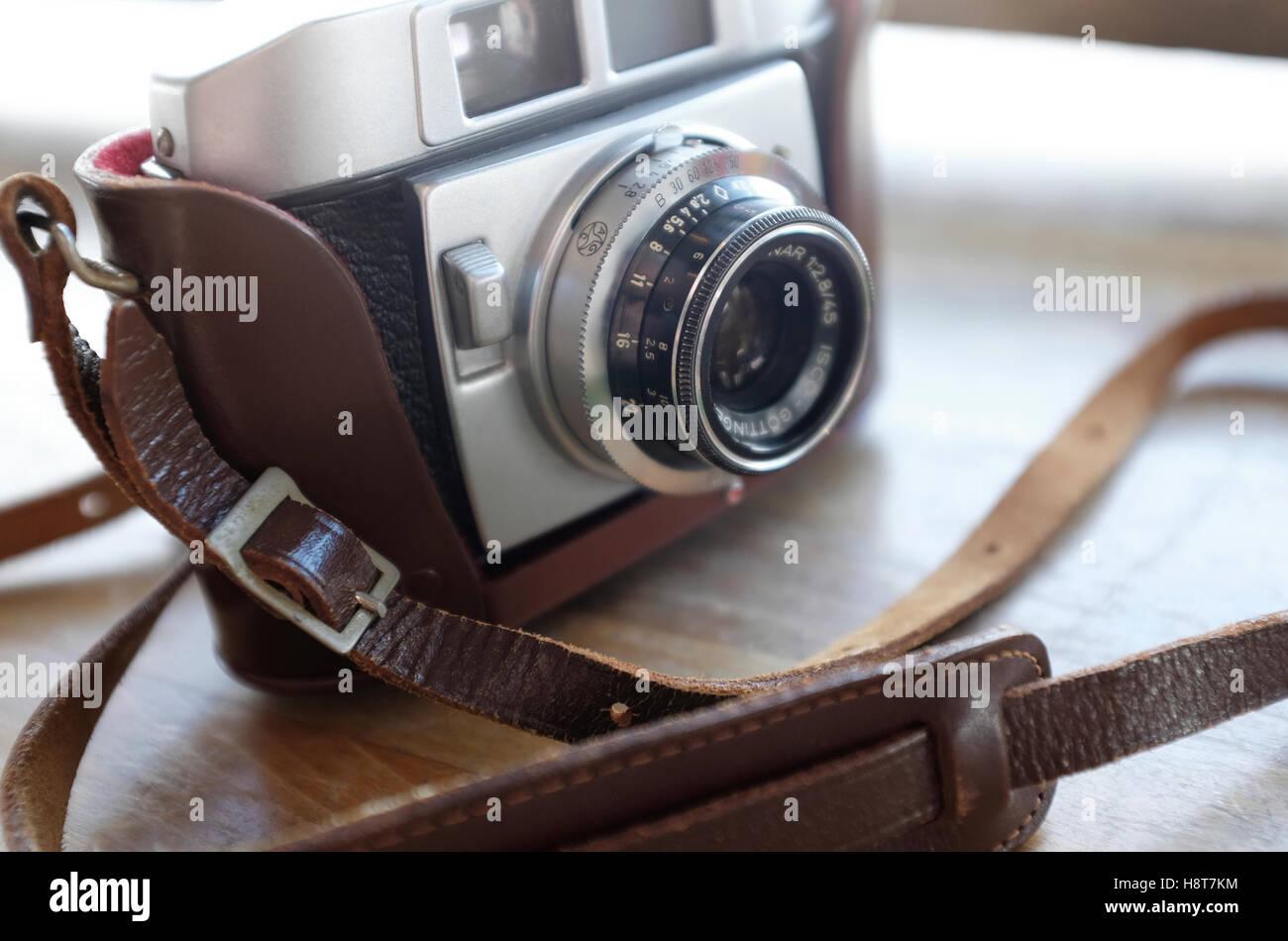 retro style vintage rangefinder camera in case - Stock Image