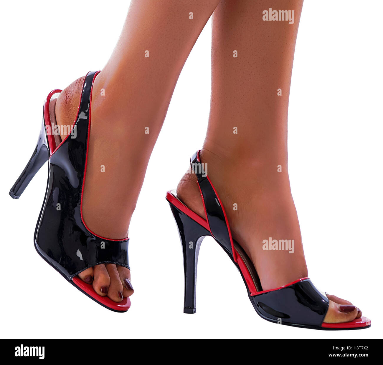 Black and red shiny patent leather stiletto high heels isolated on white background  Model Release: Yes.  Property - Stock Image