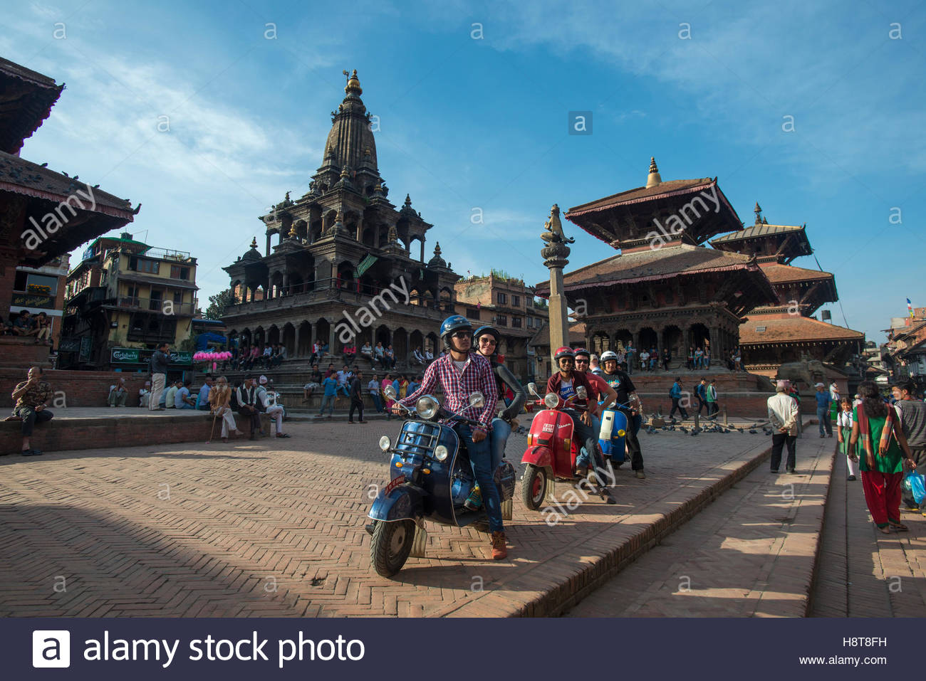 A group of tourists sit with their scooters in Kathmandu in Nepal - Stock Image