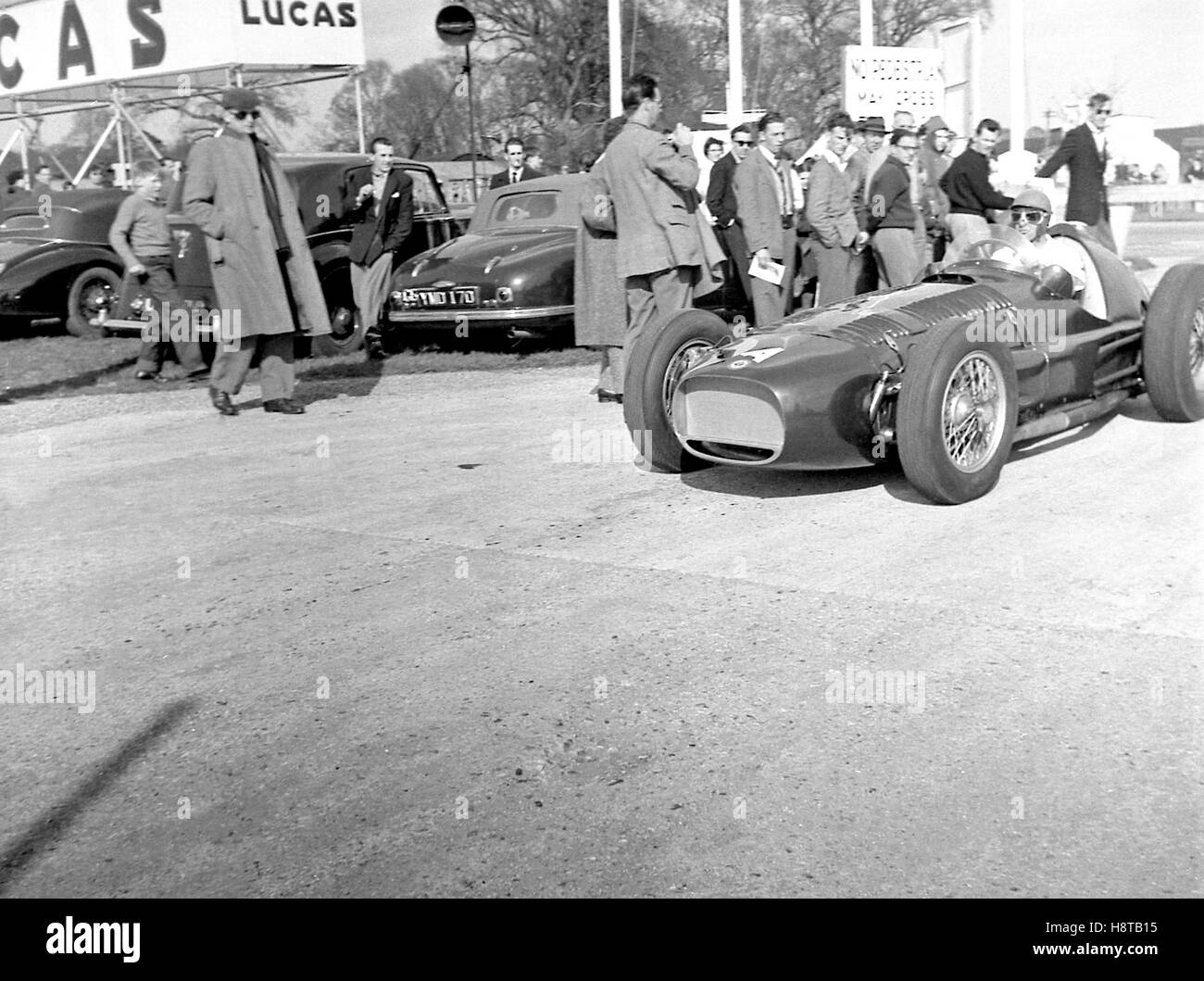 1955 GOODWOOD COLLINS BRM V16 MK II DRIVING IN - Stock Image