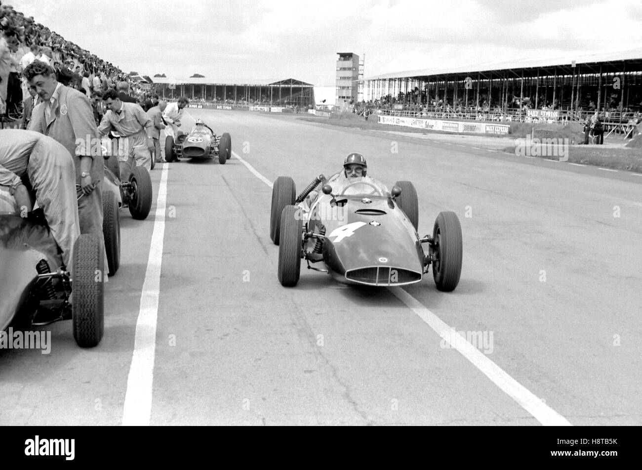 1960 MAY SILVERSTONE GRAHAM HILL BRM P48 ENTERS PITS - Stock Image
