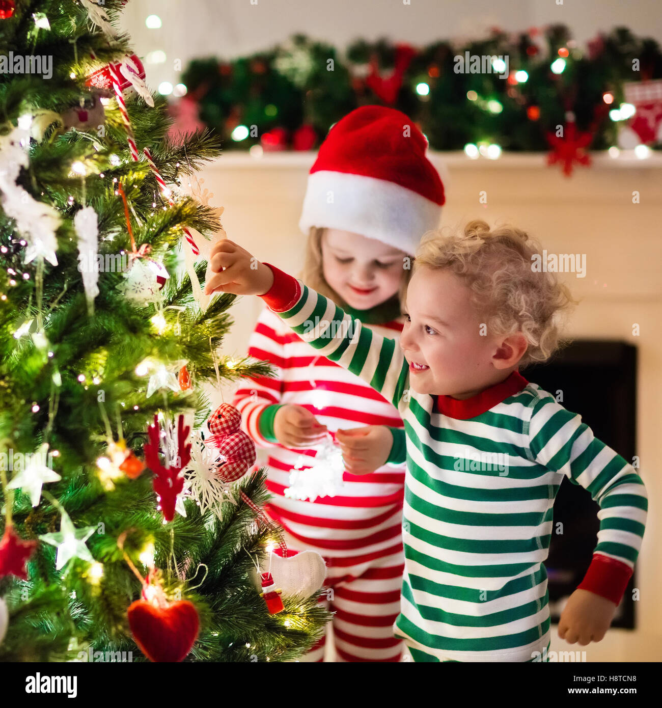 family on christmas eve at fireplace kids opening xmas presents stock photo 125926676 alamy - Xmas Presents