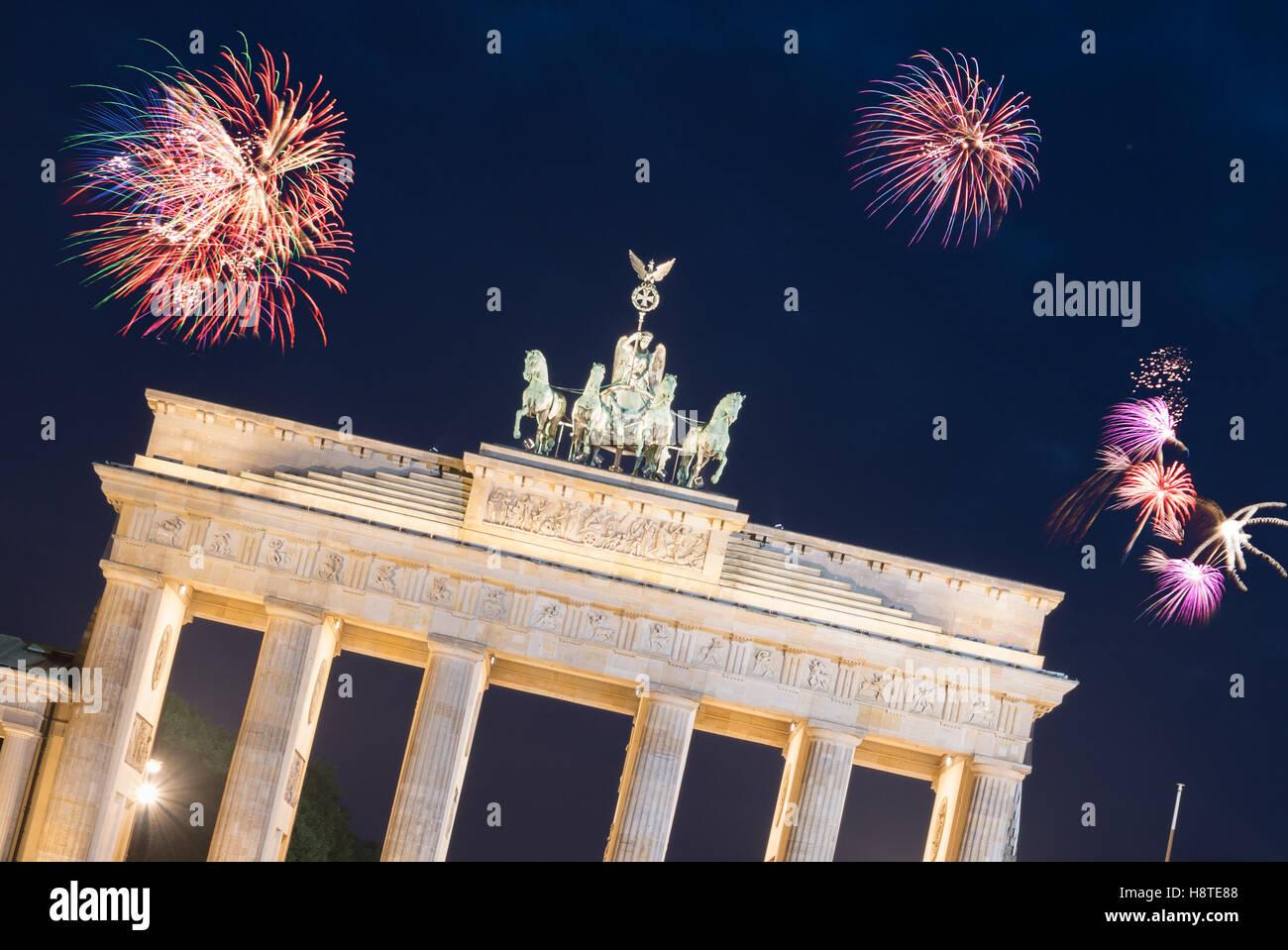 Firework over Brandenburg Gate in Berlin.  New years Eve in Germany Stock Photo