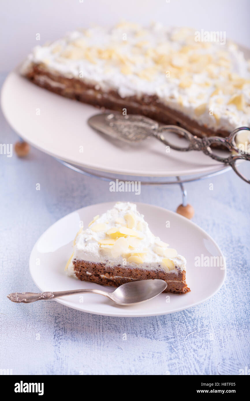 A slice of carrot cake, gluten-free, flour from rice, flax. Selective focus. - Stock Image