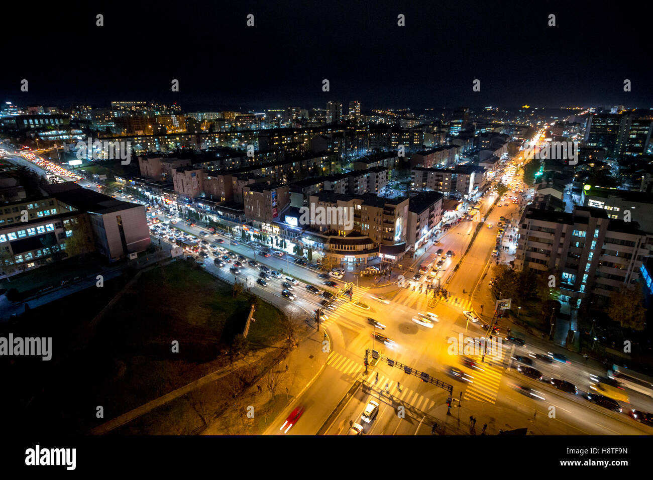 Night view of the crossroad between Bill Clinton Boulevard and George W Bush Boulevard in Pristina, Kosovo. - Stock Image