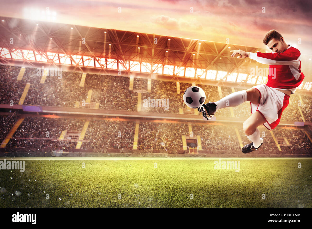 Football game at the stadium - Stock Image