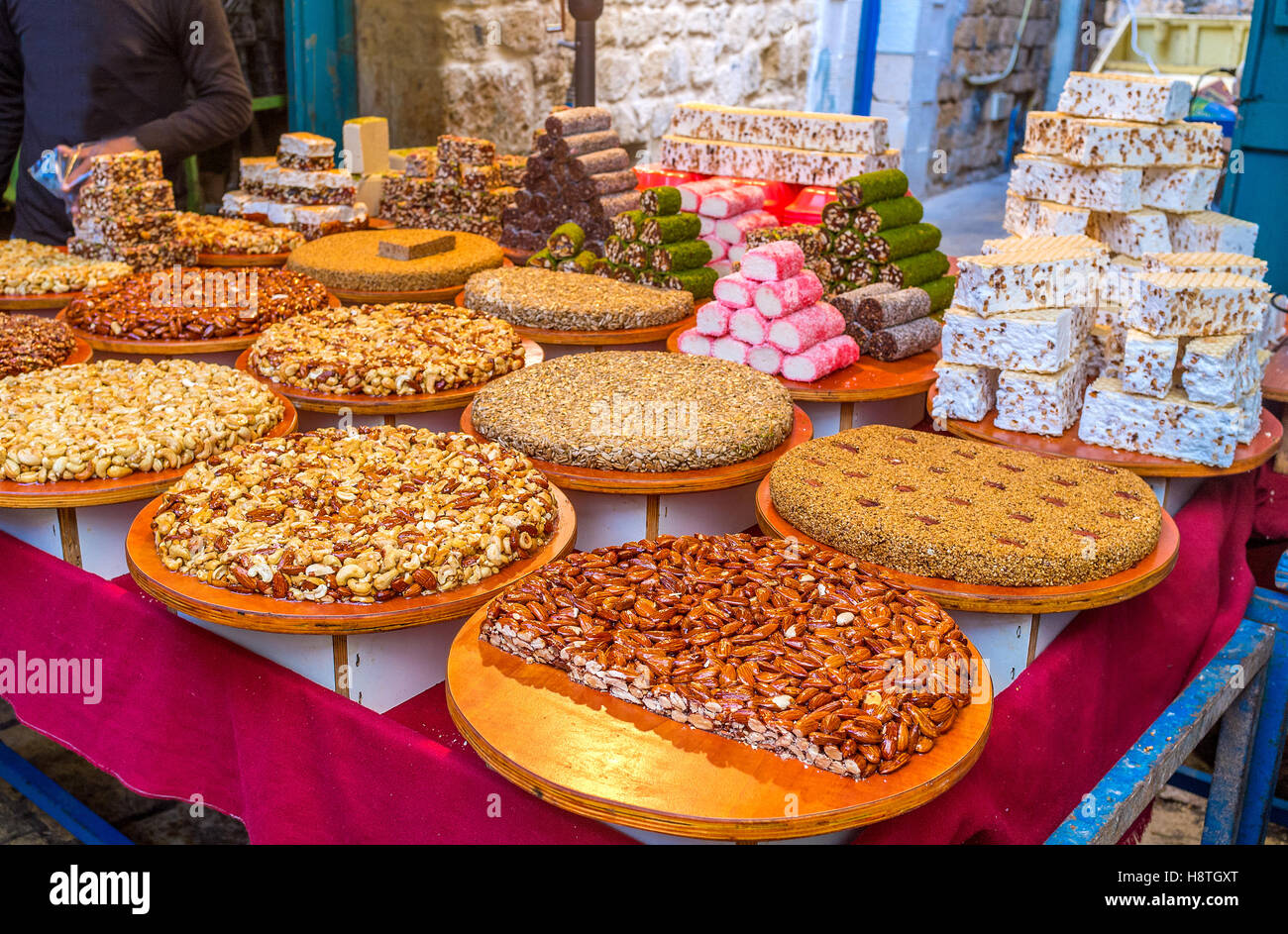 The gozinaki, made of nuts, sesame and sunflower seeds, colorful lokum and sweet halva in the stall of the Turkish - Stock Image