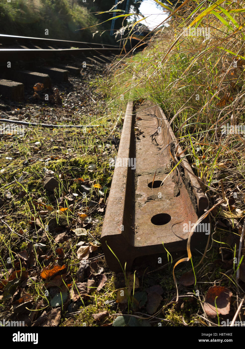 dismantled rusty rail track - Stock Image