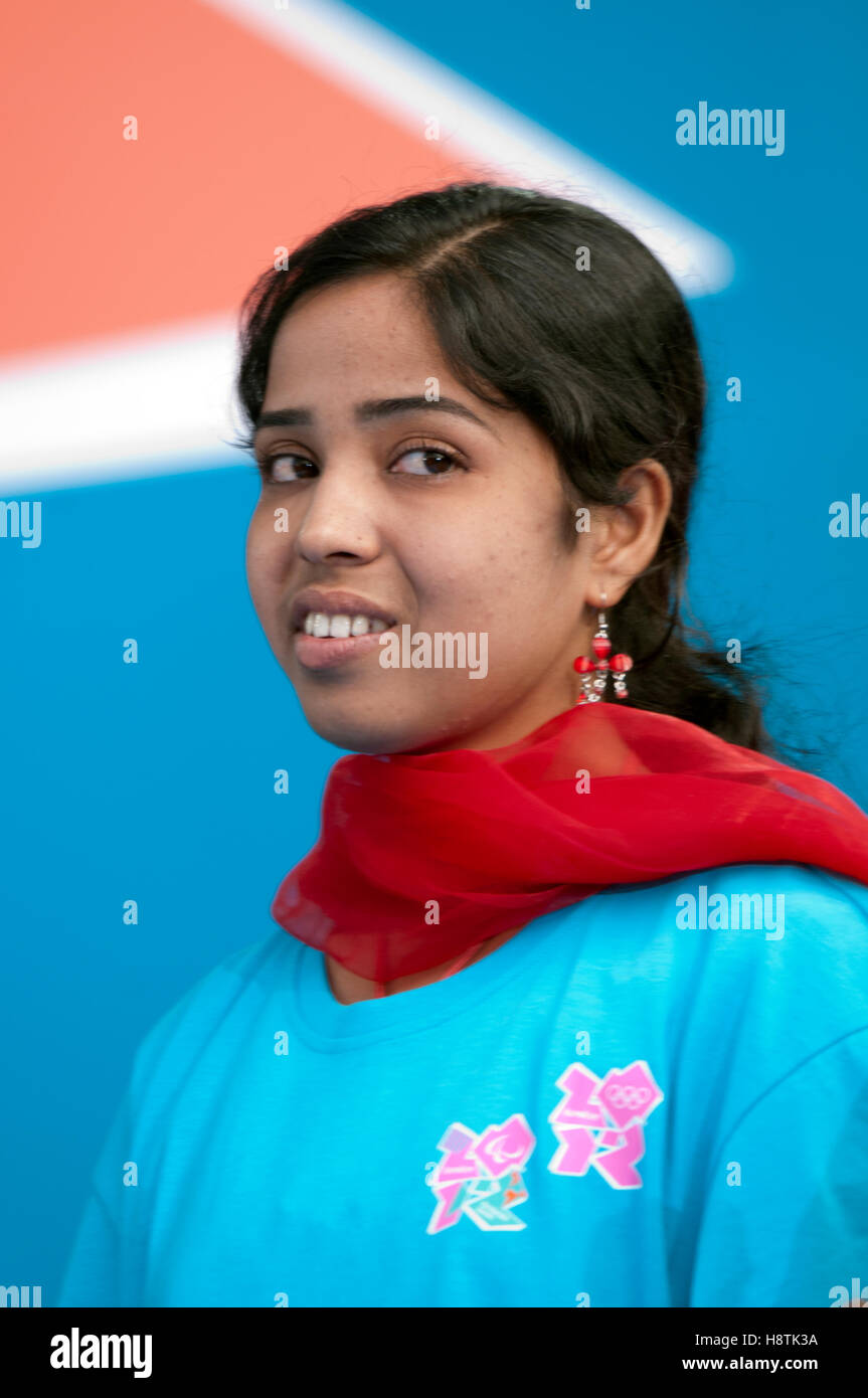 A young Bangladeshi Swimmer tells her story at the One Year To Go ceremony for the Olympics at Trafalgar Square,London - Stock Image