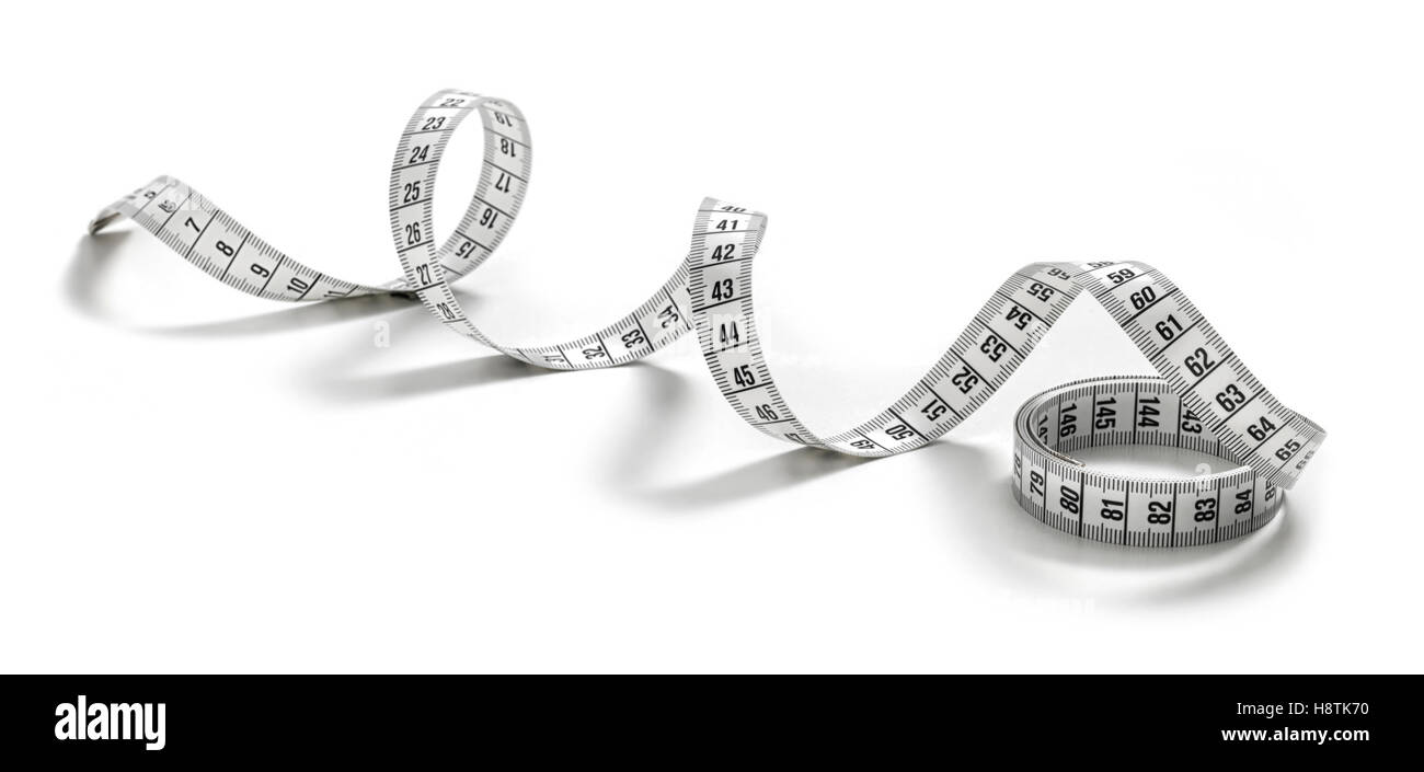 white tape measuring isolated on a white background - Stock Image