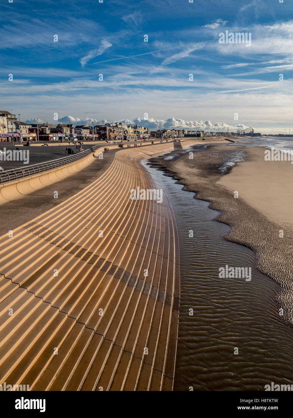 Blackpool seafront with curved stone steps down to beach, Lancashire, UK. - Stock Image