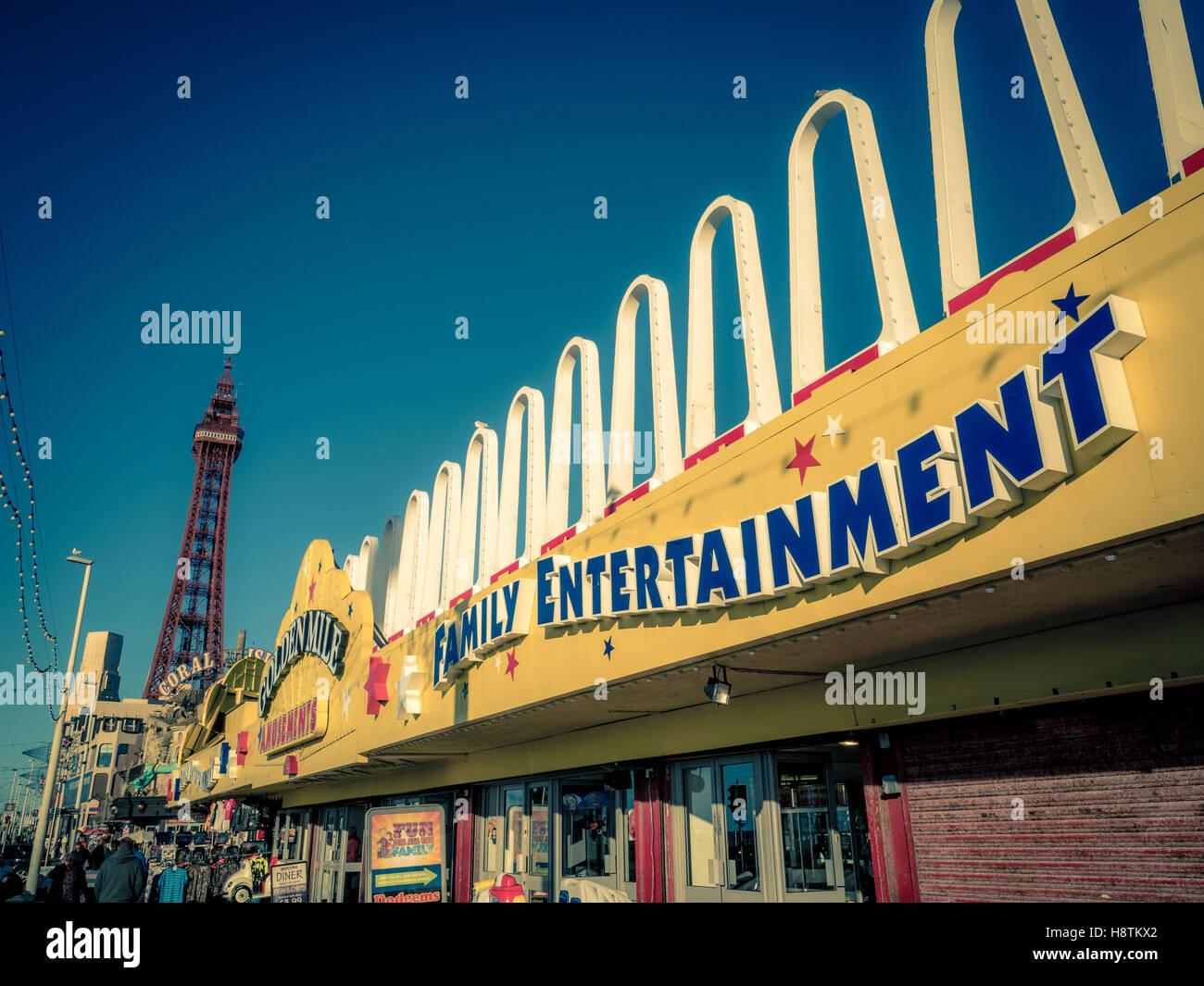 Golden Mile Family Entertainment Amusement Arcade sign on seafront, Blackpool, Lancashire, UK. - Stock Image