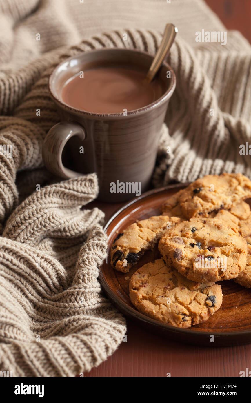 hot chocolate warming drink wool throw cozy autumn cookies - Stock Image
