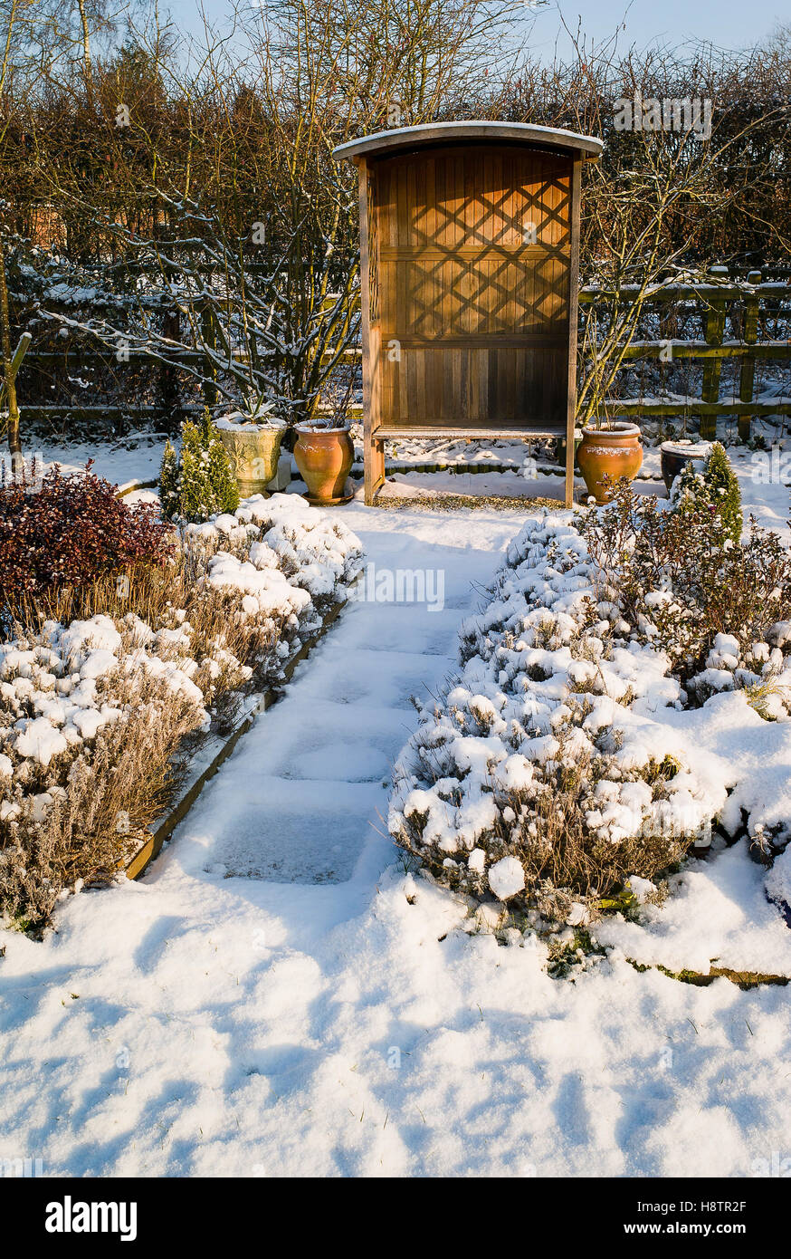 Winter Snow In A Small Garden With Path And Shelter