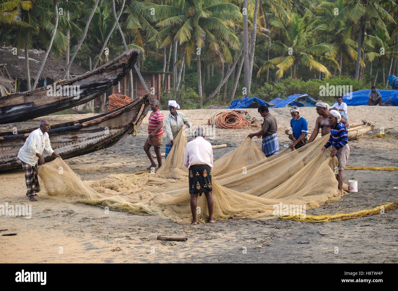 Fishermen, Varkala beach, Kerala, South India Stock Photo