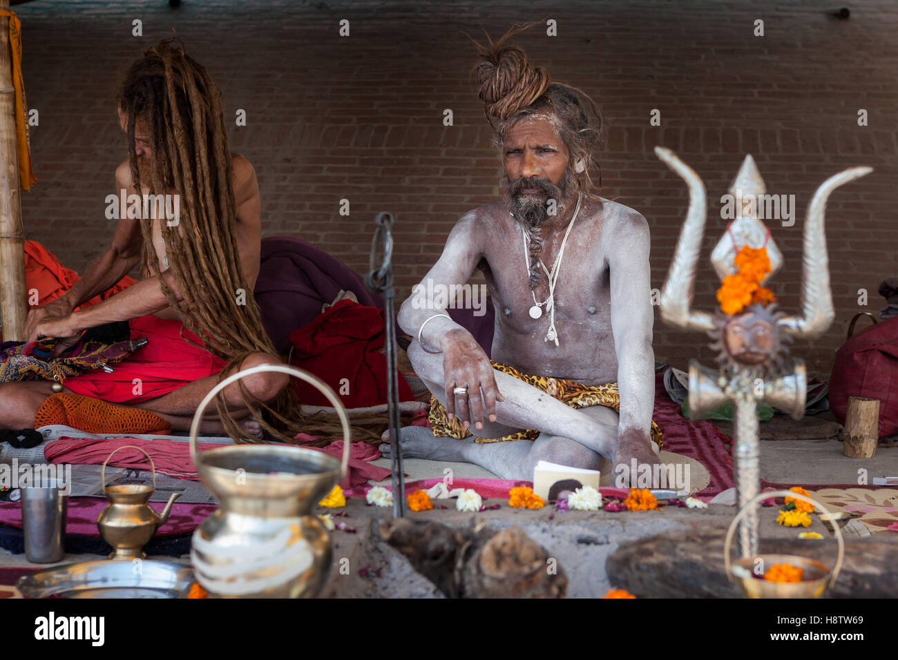 Hinduism and Buddhism have similarities in the Ganges culture, hindu and buddhist people live, pray and share together - Stock Image