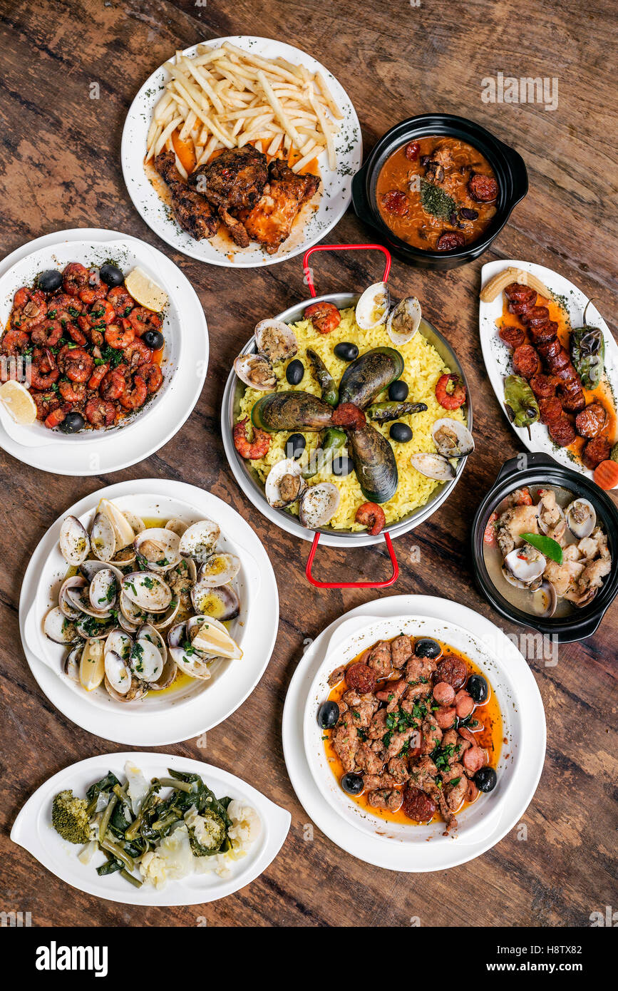 mixed portuguese traditional rustic tapas food gourmet selection on wood table - Stock Image