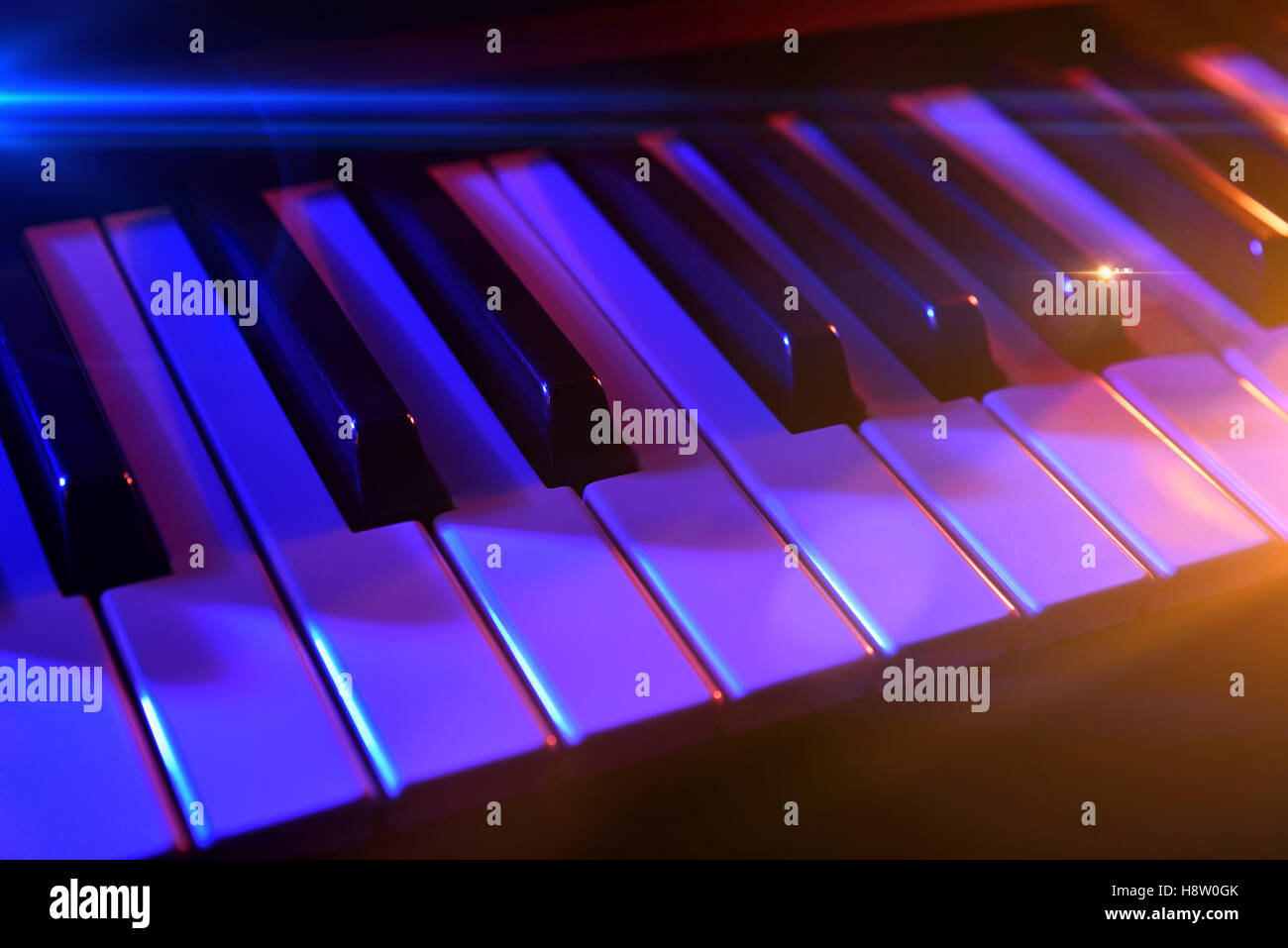 Keyboard synthesizer with colorful lights in concert. Horizontal composition. Elevated view - Stock Image