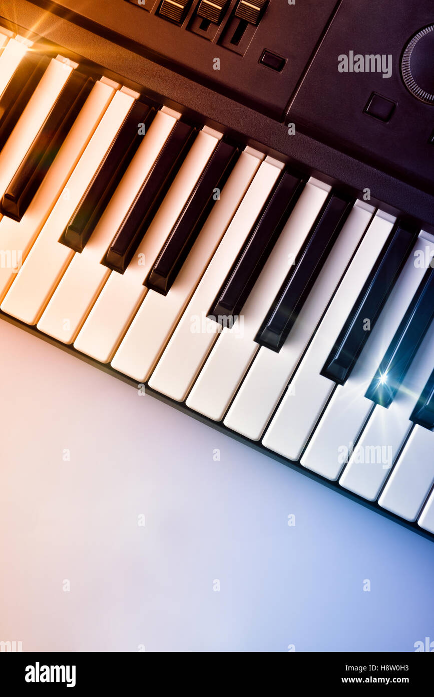 Synthesizer keyboard with shine and blue red gradient. Horizontal Composition. Top view - Stock Image