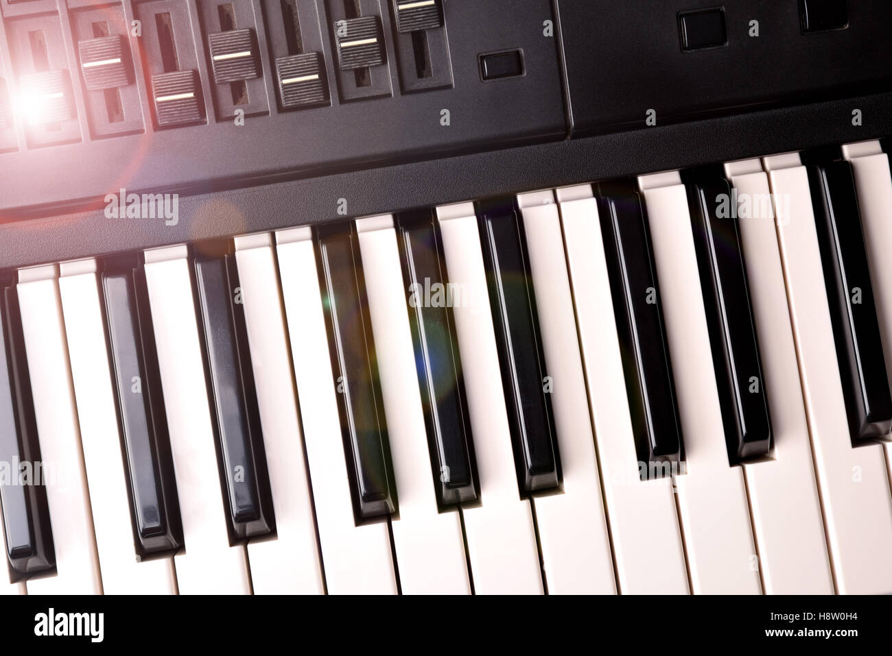 Synthesizer keyboard with shine. Horizontal Composition.Top view - Stock Image