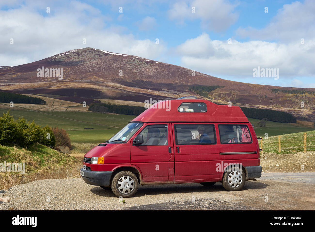 Red VW T4 Leisuredrive campervan in Glenrinnes, with Ben Rinnes behind, Moray, Scotland - Stock Image
