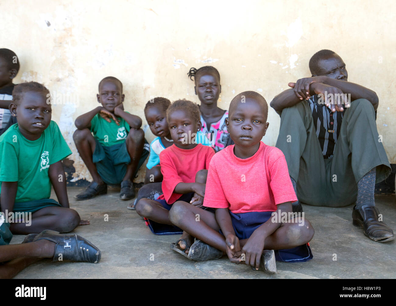 South Sudan - Uganda boarder post. Children from South Sudan waiting to get status as refugees. Nov, 2016 - Stock Image