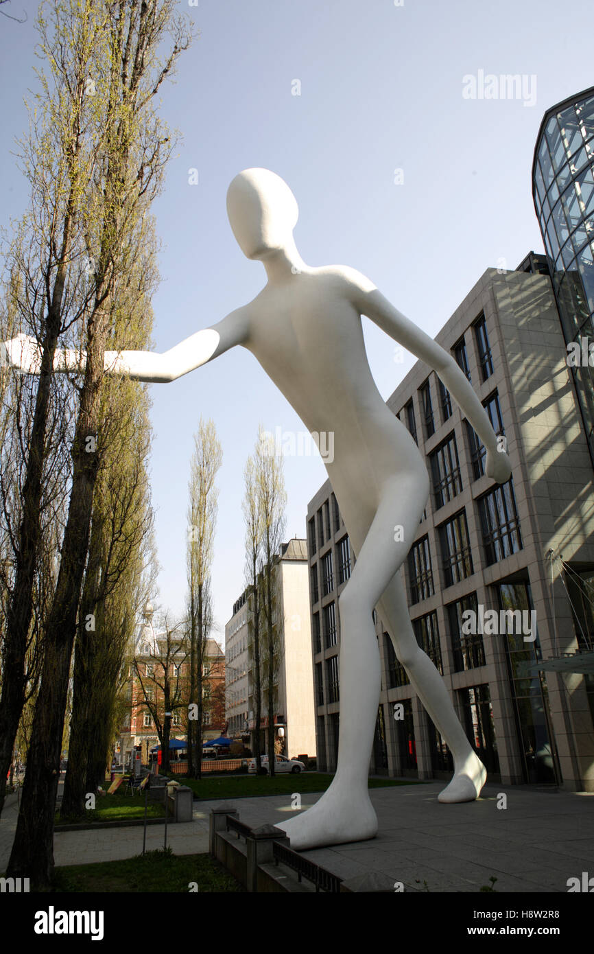 Walking Man in front of the building of the Munich Reinsurance, Leopold street, Munich, Bavaria - Stock Image